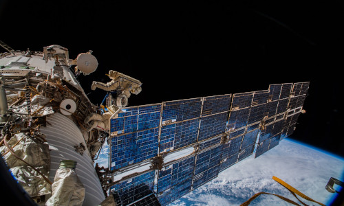 Cosmonauts installing an antenna on the International Space Station in 2018.
